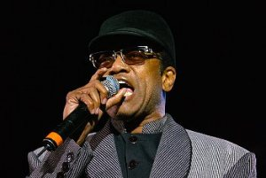 Bobby Womack in concert holding a microphone