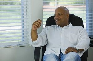 A man relaxing in his chair in his home office