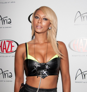 Keri Hilson vomits and faints on a plane, tweets about it.