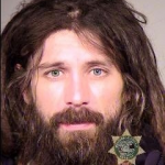He was booked into the Multnomah County Jail and will be arraigned Tuesday.