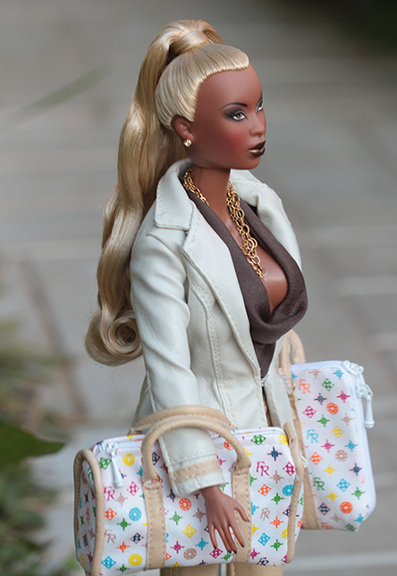 http://naturallymoi.com/wp-content/uploads/2013/02/Alleged-new-black-Barbie-Doll..png