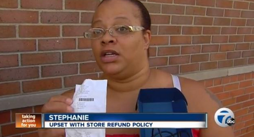 Crazed mother destroys store because she could not get a refund for her sons cell phone.
