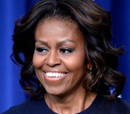 Michelle Obama teaches graduates not to fear discussions about race and racism at a speech about Brown vs Board of Education. www.naturallymoi.com
